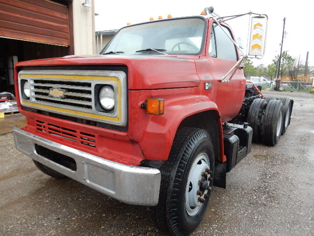 Side front view of Red 87 Chevy Day Cab truck for sale in Channelview, Tx