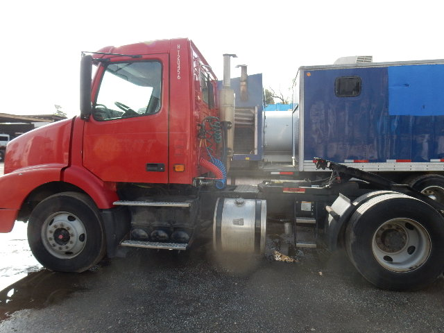 Side view of Red 06 Volvo Yard Jockey Truck