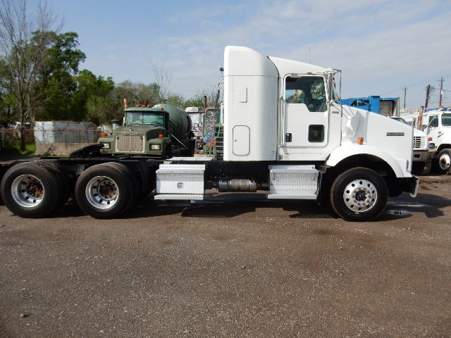 Side view of white 2011 model Kenworth Truck Tractor tandem axle with sleeper cab for sale in Channelview, Tx