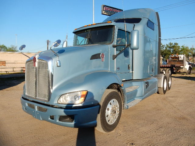 Front side view of light blue Kenworth 2012 T660 model truck tractor showing the front and sleeper cab - truck for sale in the Houston area - Channelview Texas